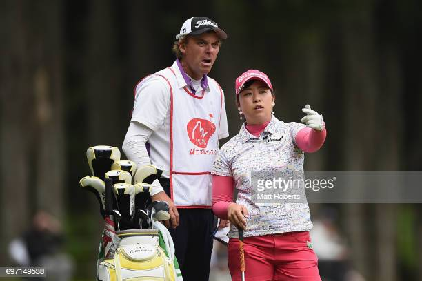 Saki Takeo of Japan speaks with her caddie during the final round of the Nichirei Ladies at the on June 18 2017 in Chiba Japan