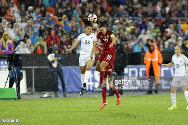 Sakina Karchaoui and Carlie Lloyd challenge for a header in heavy rainfall The United States Women's National Team hosted the France Women's National...