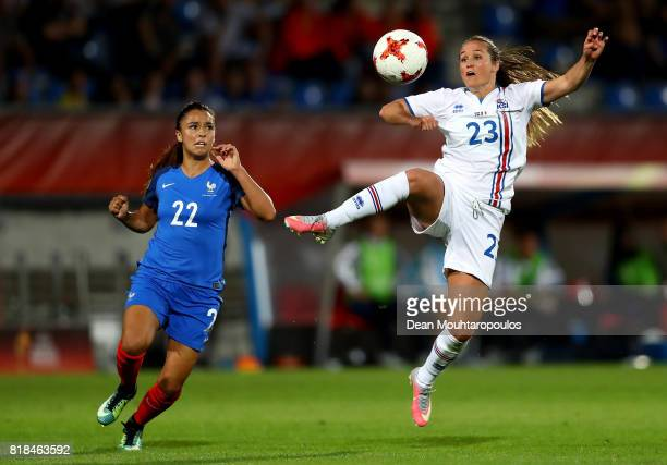 Sakina Karchaoui of France and Fanndís Fridriksdóttir of Iceland compete for the ball during the Group C match between France and Iceland during the...