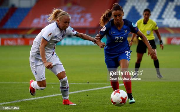 Sakina Karchaoui of France and Gunnhildur Jónsdóttir of Iceland compete for the ball during the Group C match between France and Iceland during the...