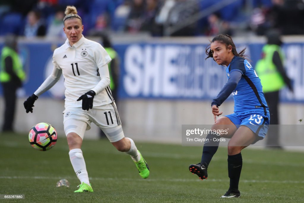 Sakina Karchaoui #23 of France in action watched by Anja Mittag #11 of Germany during the France Vs Germany SheBelieves Cup International match at Red Bull Arena on March 4, 2017 in Harrison, New Jersey.