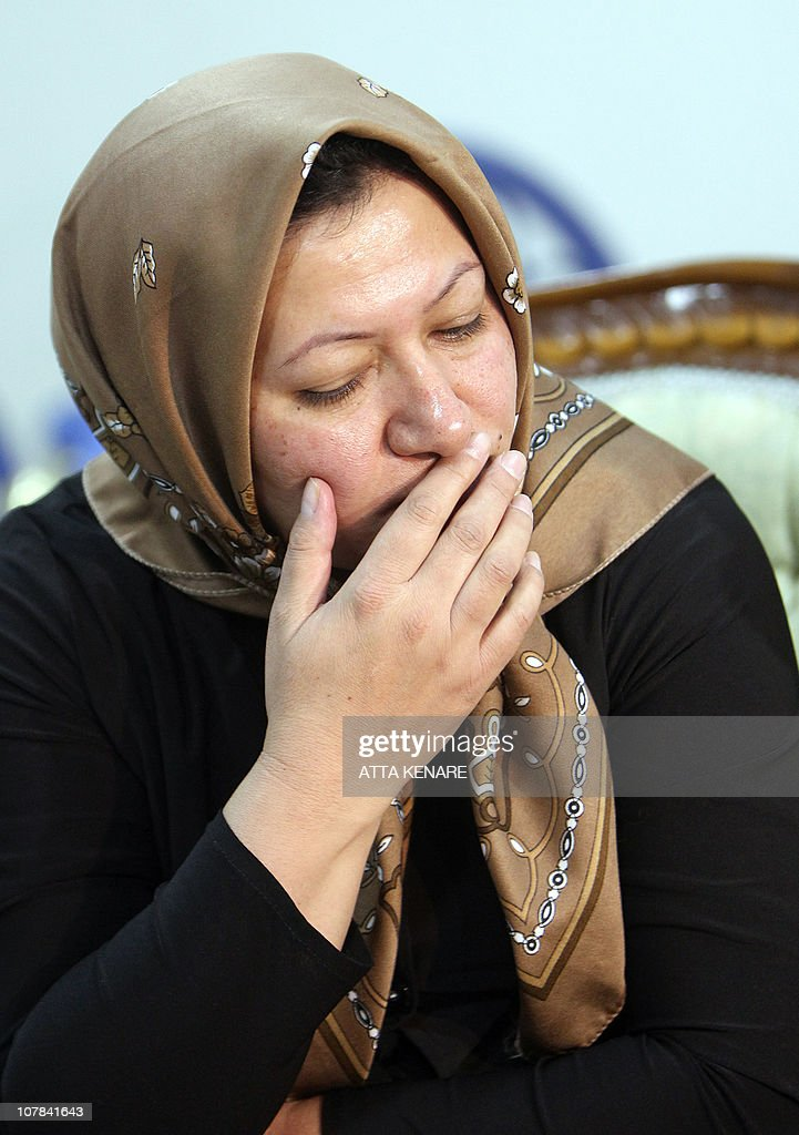 Sakineh Mohammadi Ashtiani, a 43-year-old Iranian woman sentenced to death by stoning for adultery, listens to a question as she announces to reporters in Iran's northwestern city of Tabriz on January 1, 2011 that she would sue two German journalists who have been jailed in Iran for interviewing her son.