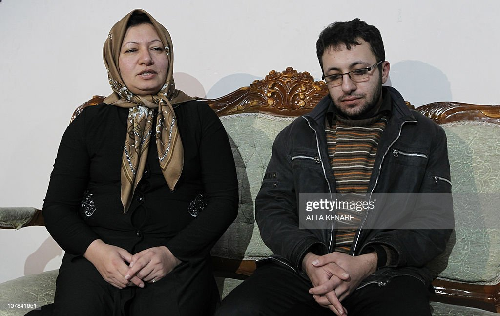 Sakineh Mohammadi Ashtiani, an Iranian woman sentenced to death by stoning for adultery, sits next to her son Sajjad Qaderzadeh during an interview with a group of journalists from international news networks in Iran's northwestern city of Tabriz on January 1, 2011. The 43-year-old woman said that she would sue two German journalists who have been jailed in Iran for interviewing her son.
