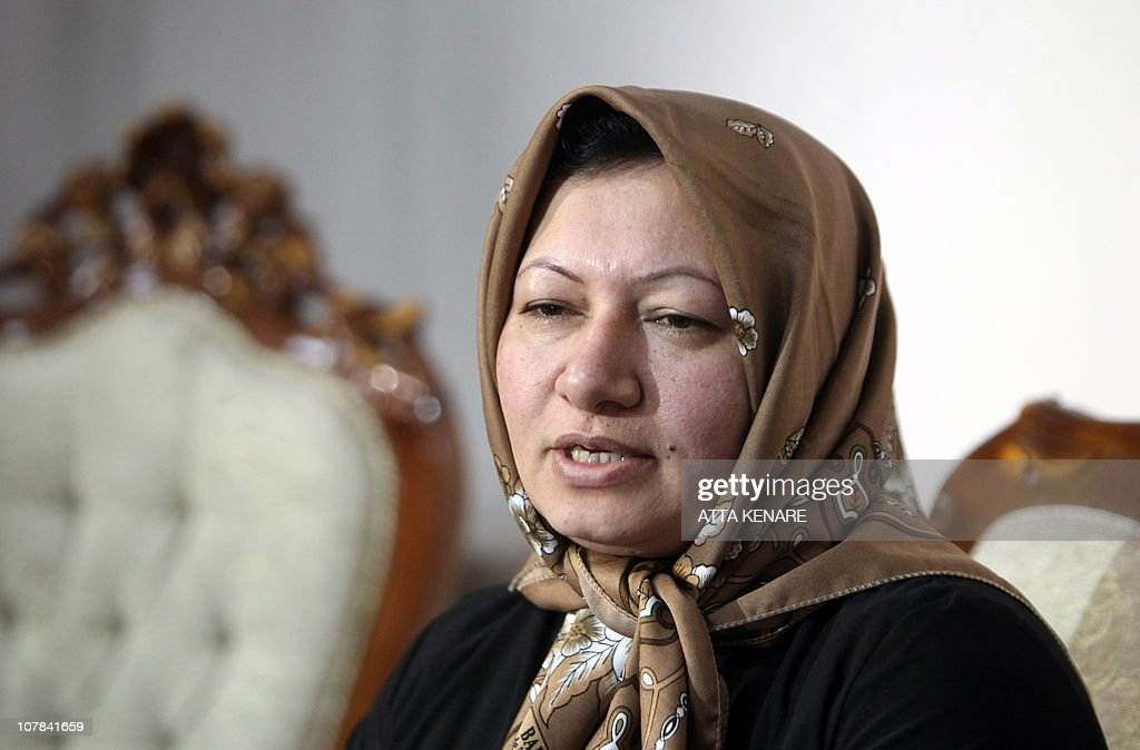 Sakineh Mohammadi Ashtiani, an Iranian woman sentenced to death by stoning for adultery, speaks during an interview with a group of journalists from international news networks at a guesthouse belonging to a government welfare organisation in Iran's northwestern city of Tabriz on January 1, 2011. The 43-year-old woman said that she would sue two German journalists who have been jailed in Iran for interviewing her son. AFP PHOTO/ATTA KENARE