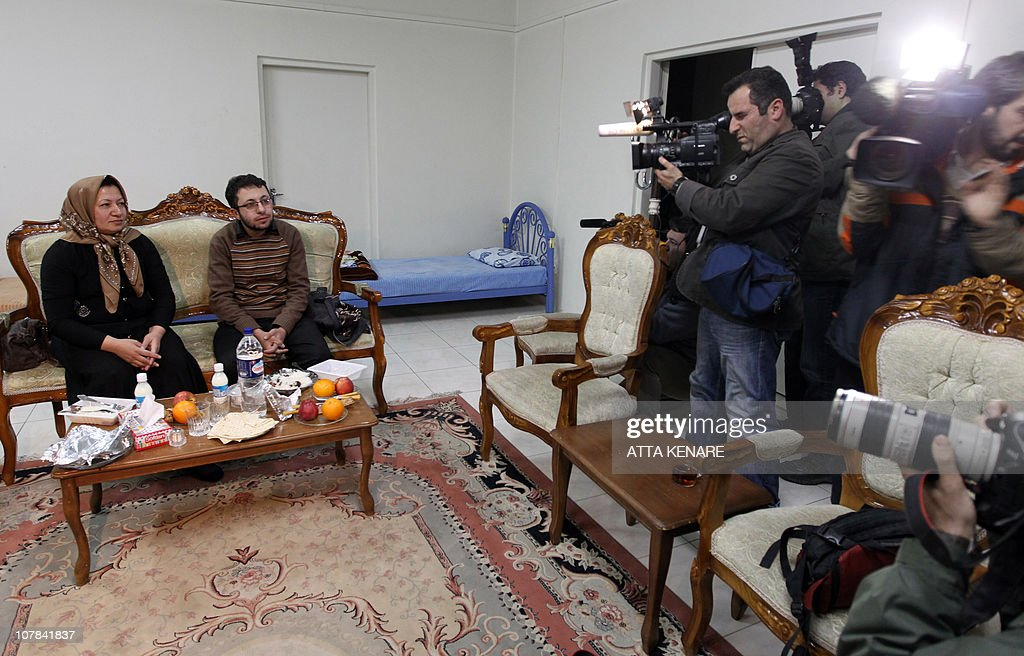Sakineh Mohammadi Ashtiani, an Iranian woman sentenced to death by stoning for adultery, sits next to her son Sajjad Qaderzadeh during an interview with a group of journalists from international news networks at a guesthouse belonging to a government welfare organisation in Iran's northwestern city of Tabriz on January 1, 2011. The 43-year-old woman said that she would sue two German journalists who have been jailed in Iran for interviewing her son.