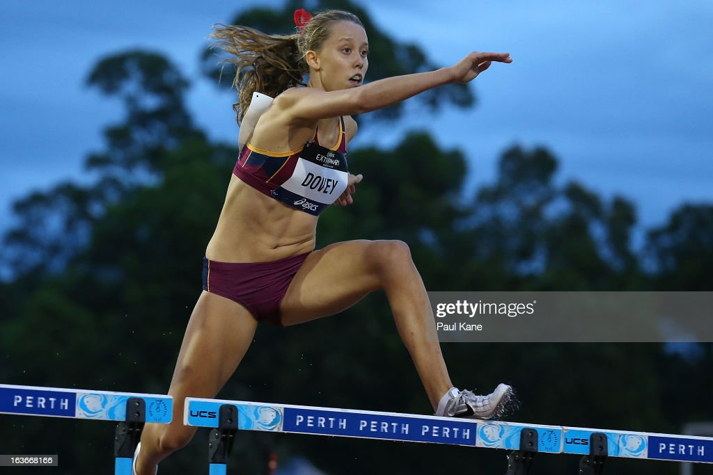 Sakisha Dovey of Queensland competes in the u18 400 metre hurdles final during day three of the Australian Junior Championships at the WA Athletics Stadium on March 14, 2013 in Perth, Australia.