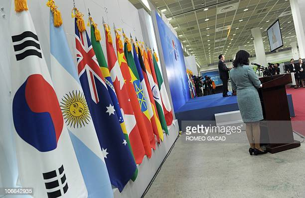 Sakong Il chairman of the G20 Seoul Summit Committee speaks to officially open the G20 international media center decorated with the flags of the G20...
