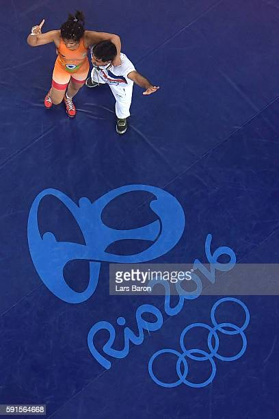 Sakshi Malik of India celebrates after defeating Aisuluu Tynybekova of Kyrgyzstan during the Women's Freestyle 58 kg Bronze match on Day 12 of the...