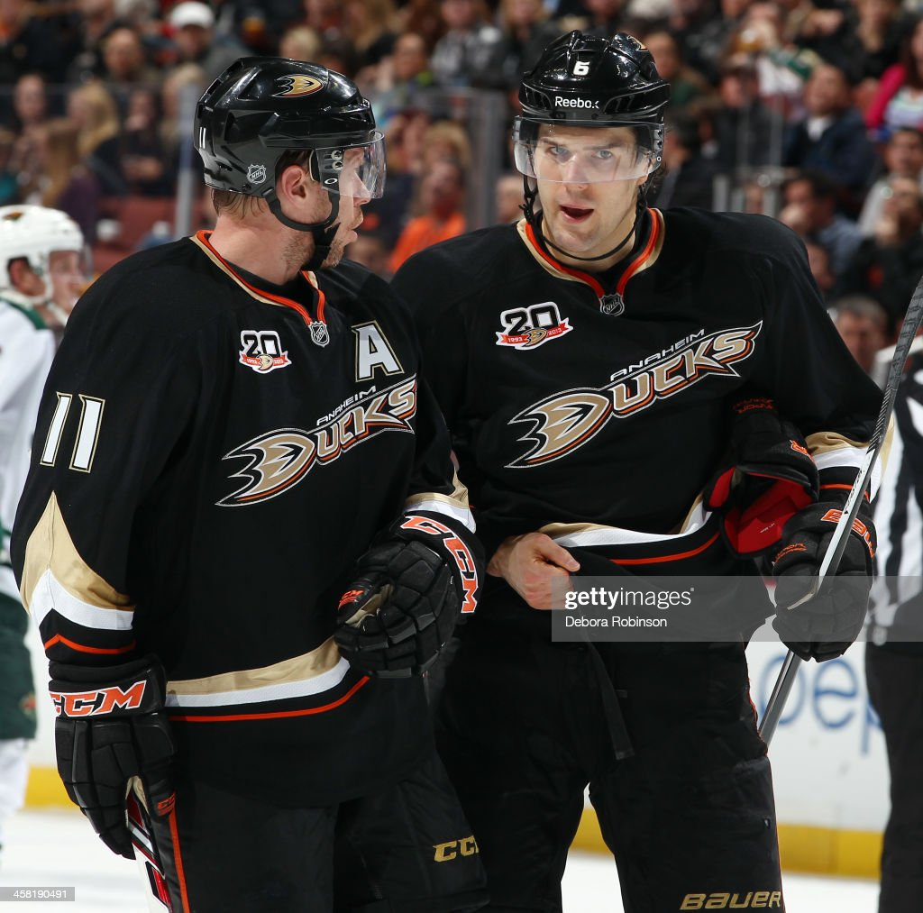 Saku Koivu #11 and Ben Lovejoy #6 of the Anaheim Ducks talk during the game against the Minnesota Wild on December 11, 2013 at Honda Center in Anaheim, California.