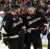 Saku Koivu and Ben Lovejoy of the Anaheim Ducks talk during the game against the Minnesota Wild on December 11 2013 at Honda Center in Anaheim...
