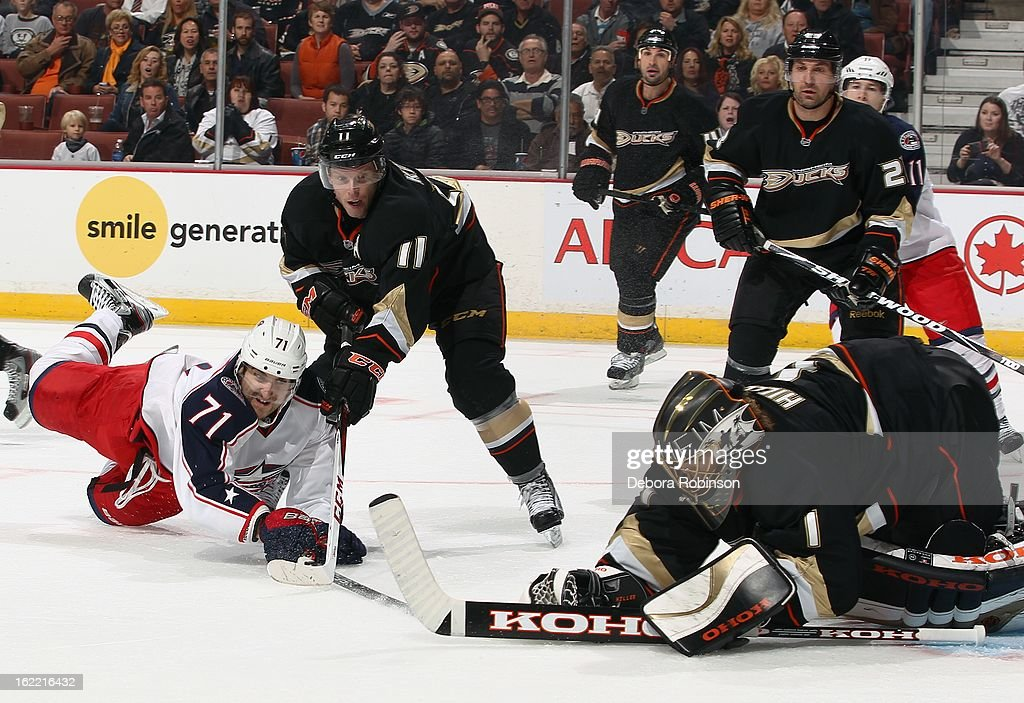 Saku Koivu #11 and goalie Jonas Hiller #1 of the Anaheim Ducks attempt to defend a shot by Nick Foligno #71 of the Columbus Blue Jackets as Ducks teammates Sheldon Souray #44 and Francois Beauchemin #23 look on. February 18, 2013 at Honda Center in Anaheim, California.