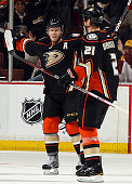 Saku Koivu and Sheldon Brookbank of the Anaheim Ducks celebrate a second period goal from Brookbank against the Chicago Blackhawks during the game on...