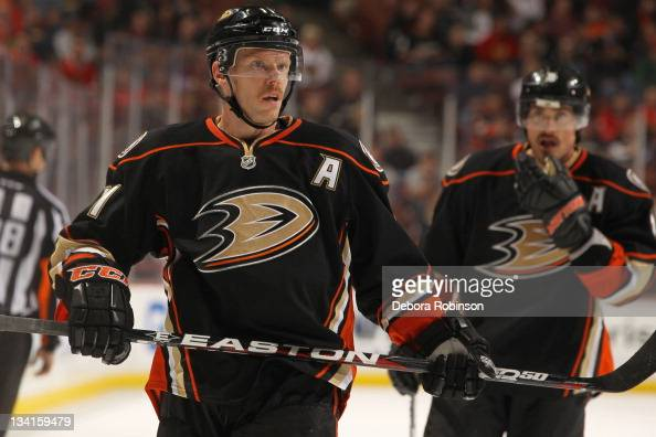 Saku Koivu and Teemu Selanne of the Anaheim Ducks look on during their game against the Chicago Blackhawks at Honda Center on November 25 2011 in...