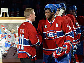 Saku Koivu during pregame ceremony being held in his honour greets PK Subban of the Montreal Canadiens prior to the game against the Anaheim Ducks at...