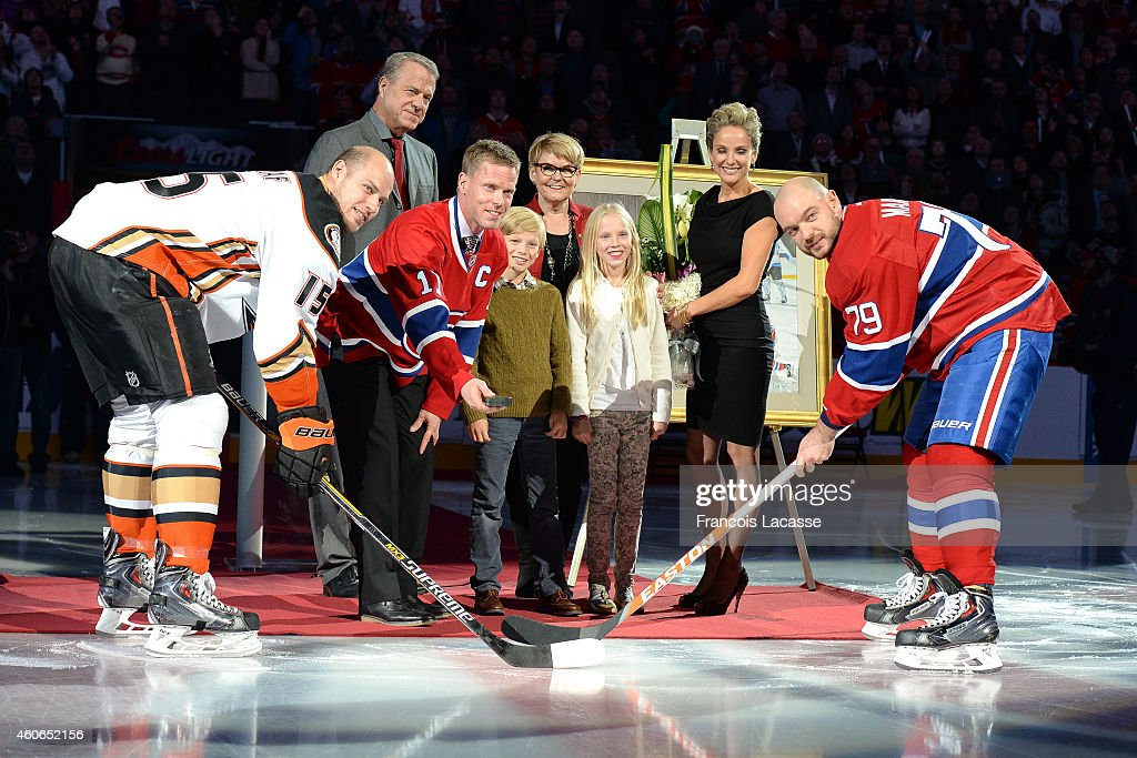 Saku Koivu during pregame ceremony being held in his honour with his family members and the captains Andrei Markov of the Montreal Canadiens and Ryan...