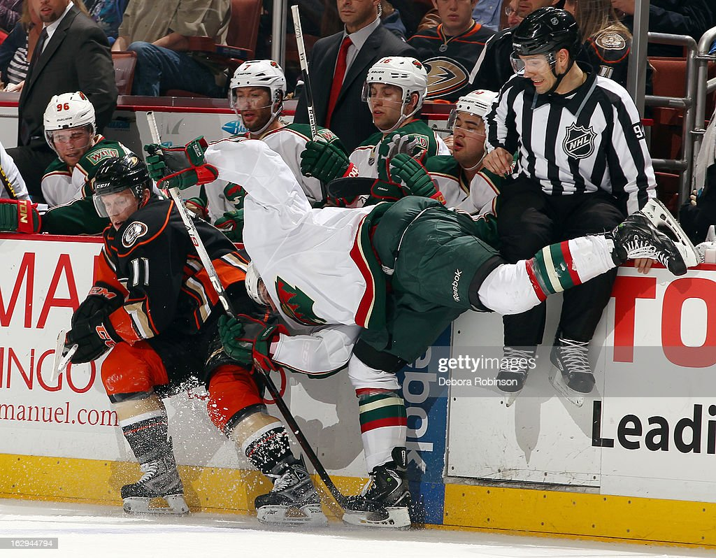 <a gi-track='captionPersonalityLinkClicked' href=/galleries/search?phrase=Saku+Koivu&family=editorial&specificpeople=202253 ng-click='$event.stopPropagation()'>Saku Koivu</a> #11 of the Anaheim Ducks against the Minnesota Wild as linesmen Bryan Pancich avoids contact on March 1, 2013 at Honda Center in Anaheim, California.