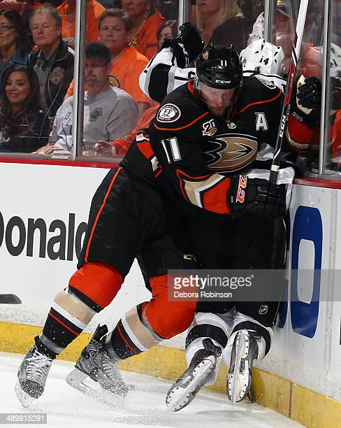 Saku Koivu of the Anaheim Ducks battles for position against Justin Williams of the Los Angeles Kings in Game Five of the Second Round of the 2014...