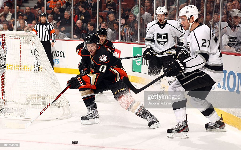 Saku Koivu #11 of the Anaheim Ducks battles for the puck against Alec Martinez #27 of the Los Angeles Kings on February 2, 2013 at Honda Center in Anaheim, California.