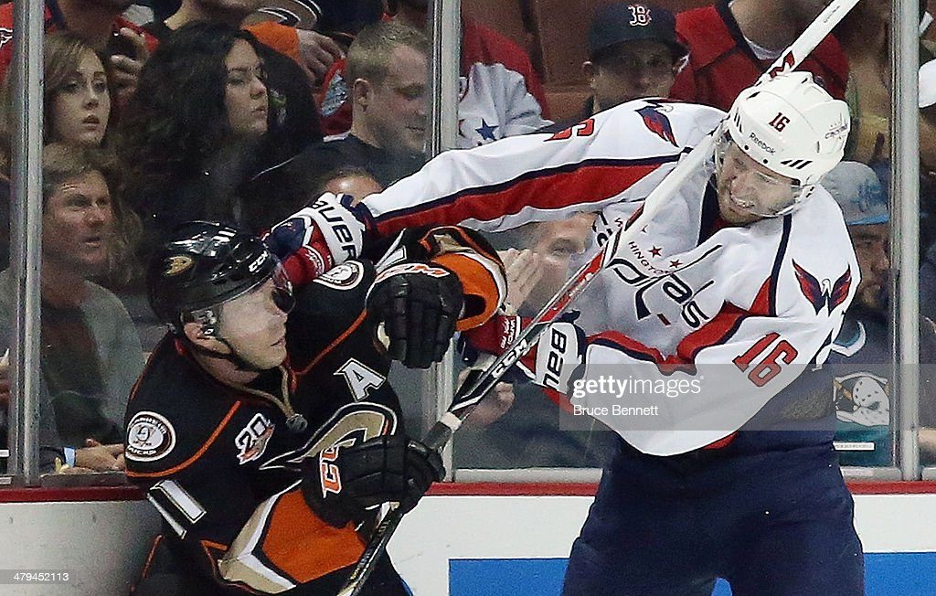 Saku Koivu #11 of the Anaheim Ducks battles with Eric Fehr #16 of the Washington Capitals during the second period at the Honda Center on March 18, 2014 in Anaheim, California.