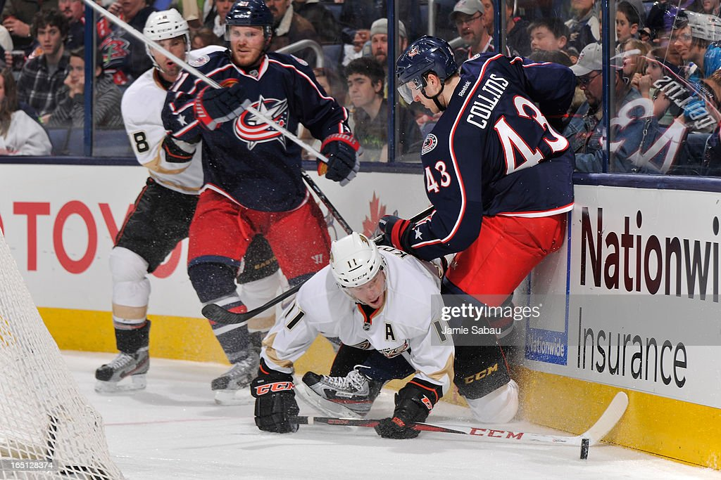 <a gi-track='captionPersonalityLinkClicked' href=/galleries/search?phrase=Saku+Koivu&family=editorial&specificpeople=202253 ng-click='$event.stopPropagation()'>Saku Koivu</a> #11 of the Anaheim Ducks continues to play the puck after being knocked down by Sean Collins #43 of the Columbus Blue Jackets during the second period on March 31, 2013 at Nationwide Arena in Columbus, Ohio.