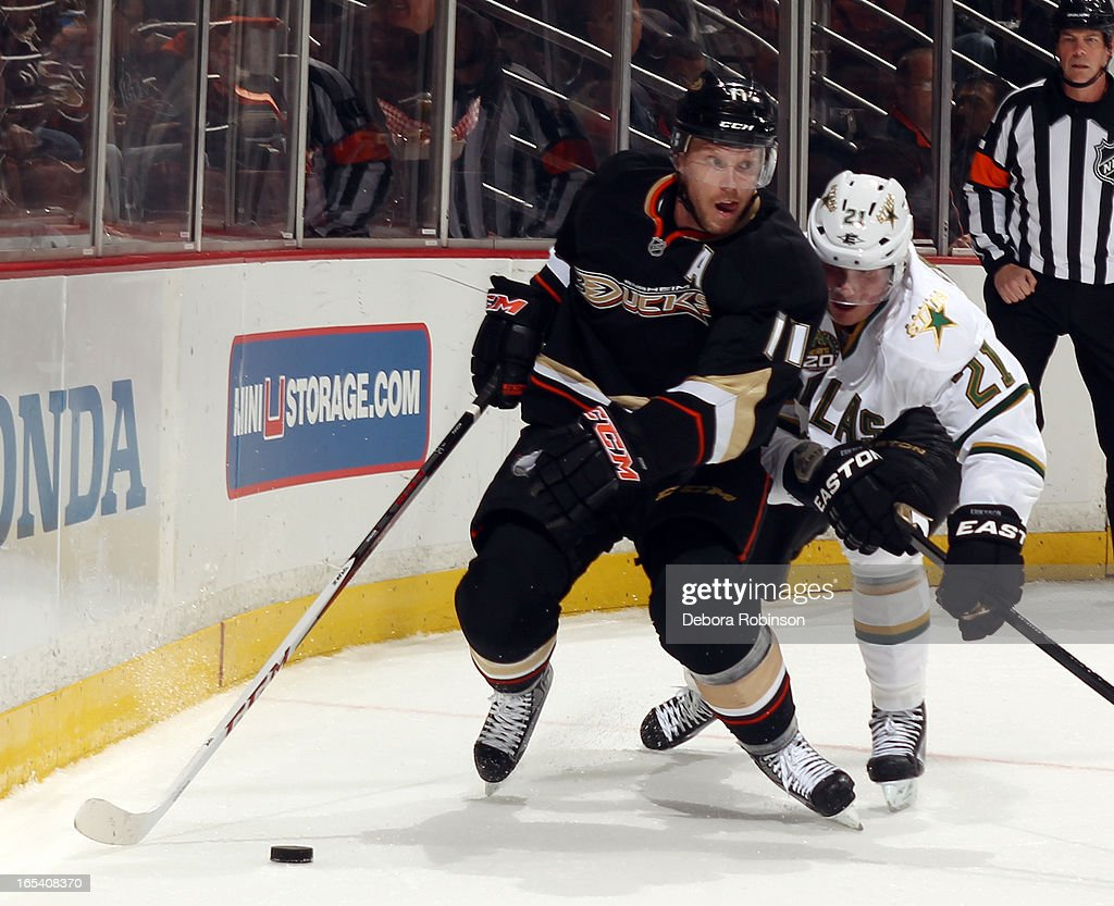 Saku Koivu #11 of the Anaheim Ducks handles the puck against Loui Eriksson #21 of the Dallas Stars on April 3, 2013 at Honda Center in Anaheim, California.