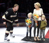Saku Koivu of the Anaheim Ducks is accompanied by his wife Hanna and two children Ilona and Aatos as he was honored Wednesday evening for reaching...