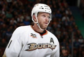 Saku Koivu of the Anaheim Ducks looks on from the bench during their NHL game against the Vancouver Canucks at Rogers Arena March 29 2014 in...