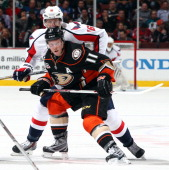 Saku Koivu of the Anaheim Ducks skates against Eric Fehr of the Washington Capitals on March 18 2014 at Honda Center in Anaheim California