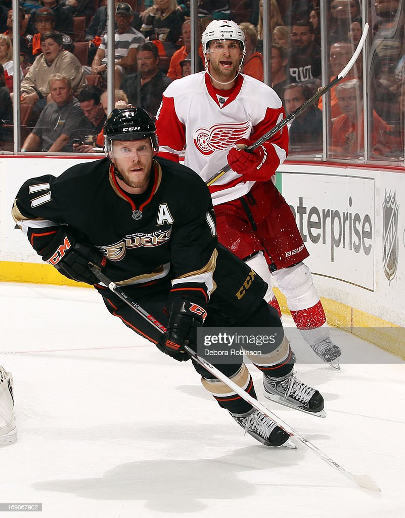 Saku Koivu #11 of the Anaheim Ducks skates against Jakub Kindl #4 of the Detroit Red Wings in Game Seven of the Western Conference Quarterfinals during the 2013 NHL Stanley Cup Playoffs at Honda Center on May 12, 2013 in Anaheim, California.