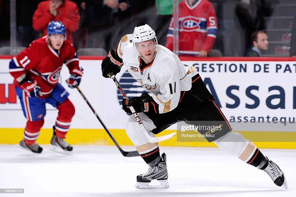 <a gi-track='captionPersonalityLinkClicked' href=/galleries/search?phrase=Saku+Koivu&family=editorial&specificpeople=202253 ng-click='$event.stopPropagation()'>Saku Koivu</a> #11 of the Anaheim Ducks skates during his last shift of the NHL game against the Montreal Canadiens at the Bell Centre on October 24, 2013 in Montreal, Quebec, Canada.