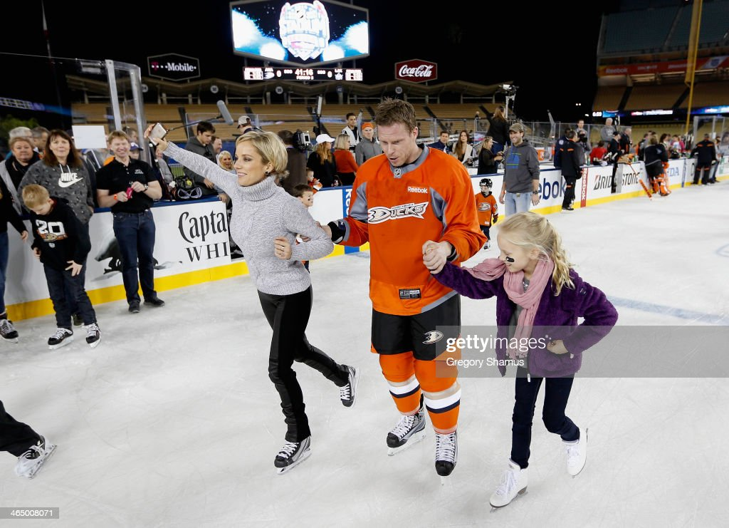 <a gi-track='captionPersonalityLinkClicked' href=/galleries/search?phrase=Saku+Koivu&family=editorial&specificpeople=202253 ng-click='$event.stopPropagation()'>Saku Koivu</a> #11 of the Anaheim Ducks skates with his daughter and wife during the family skate after the team practice for the 2014 Coors Light NHL Stadium Series against the Los Angeles Kings at Dodger Stadium on January 24, 2014 in Los Angeles, California.