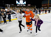 Saku Koivu of the Anaheim Ducks skates with his daughter and wife during the family skate after the team practice for the 2014 Coors Light NHL...