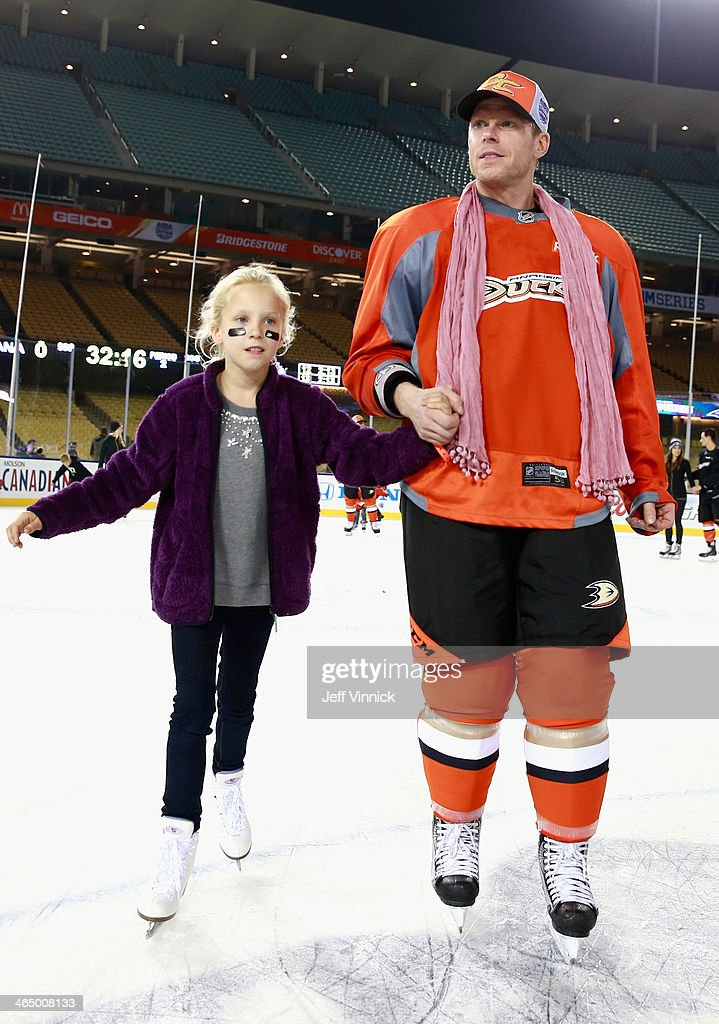 Saku Koivu of the Anaheim Ducks skates with his daughter during the family skate after the team practice for the 2014 Coors Light NHL Stadium Series...