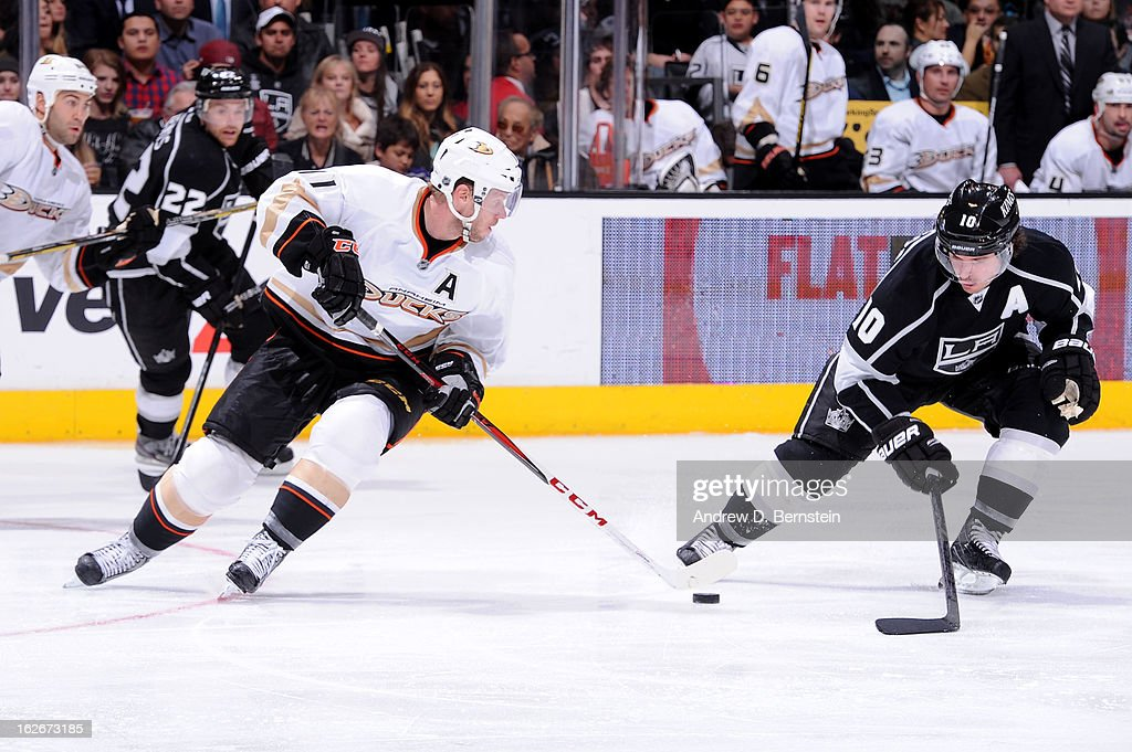 Saku Koivu #11 of the Anaheim Ducks skates with the puck against Mike Richards #10 of the Los Angeles Kings at Staples Center on February 25, 2013 in Los Angeles, California.