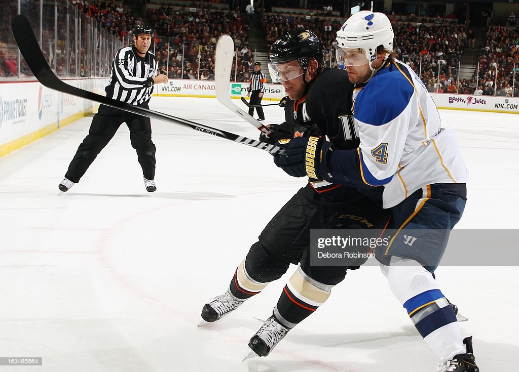 Saku Koivu #11 of the Anaheim Ducks works past Kris Russell #4 of the St. Louis Blues on March 10, 2013 at Honda Center in Anaheim, California.
