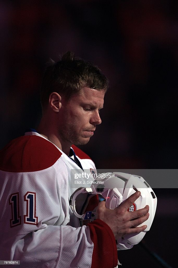 Saku Koivu of the Montreal Canadiens stands on the ice for the National Anthems prior to the start of the game against the Florida Panthers at the...