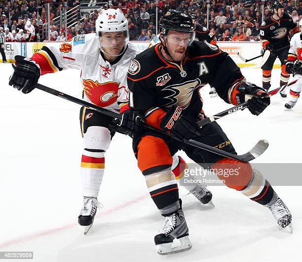Saku Koivu the Anaheim Ducks battles for position against Jiri Hudler of the Calgary Flames on November 29 2013 at Honda Center in Anaheim California