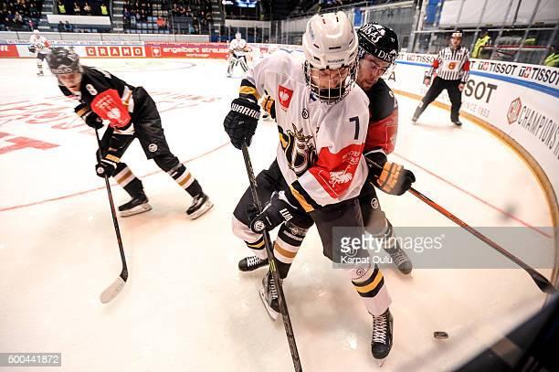 Saku Maenalanen and Simon Suoranta of Karpat Oulu compete for a puck with Urho Vaakanainen of Espoo Blues during the Champions Hockey League quarter...