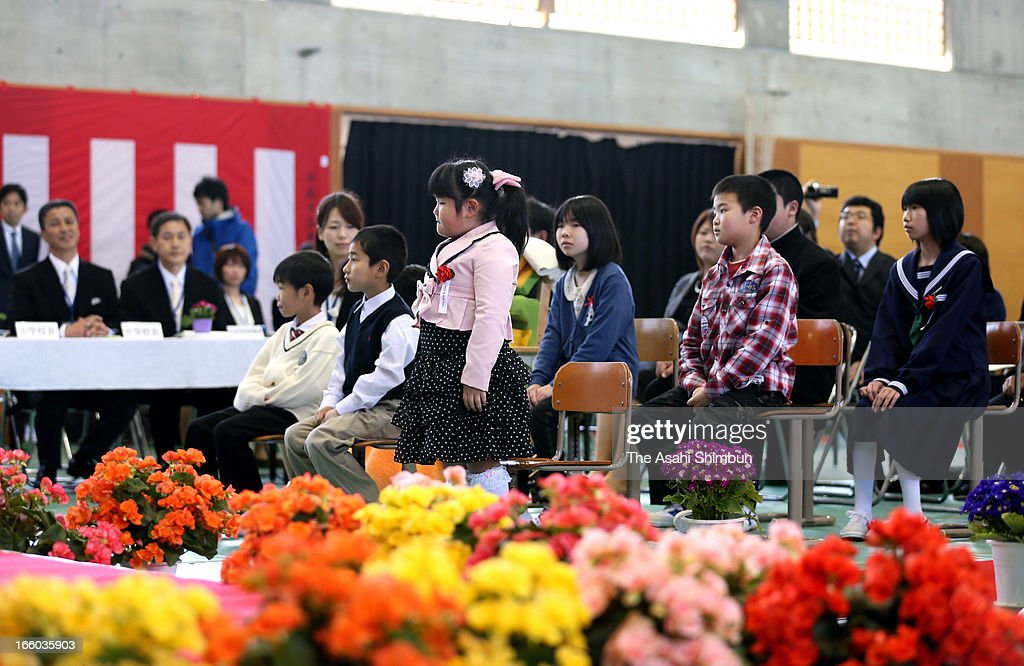 Sakura Watanabe, only new pupil of the newly opened Katsurao Elementary School Miharu Campus, attends her entering ceremony on April 8, 2013 in Miharu, Fukushima, Japan. All the residents of Katsurao village have been evacuated as the most area is designated as no-go zone of Fukushima Daiichi Nuclear Power Plant.