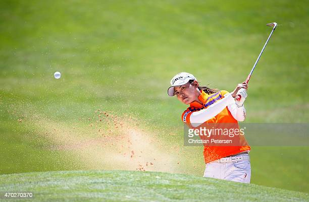 Sakura Yokomine of Japan chips from the bunker onto the fourth green during the final round of the LPGA LOTTE Championship Presented By Hershey at Ko...