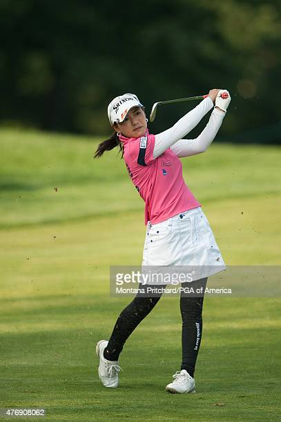 Sakura Yokomine of Japan hits her shot on four during Round Two of the 2015 KPMG Women's PGA Championship held at Westchester Country Club on June 12...