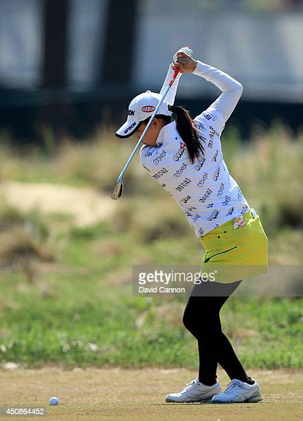 Sakura Yokomine of Japan plays her second shot at the par 4 18th hole during the first round of the 69th US Women's Open at Pinehurst Resort Country...