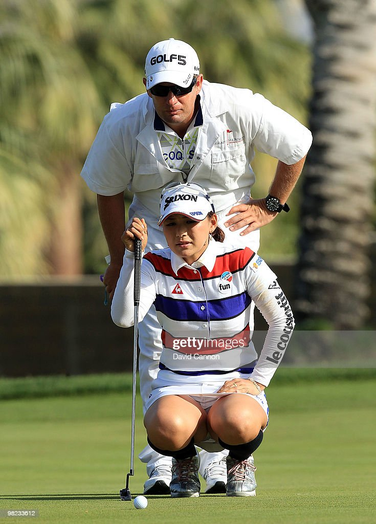 Sakura Yokomine of Japan putting at the 15th hole during the third round of the 2010 Kraft Nabisco Championship on the Dinah Shore Course at The...