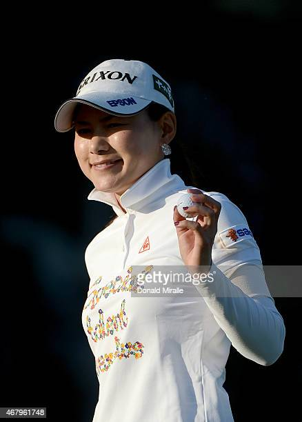 Sakura Yokomine of Japan reacts to her putt on the 18th hole during Round Three of the LPGA KIA Classic at the Aviara Golf Club on March 28 2015 in...