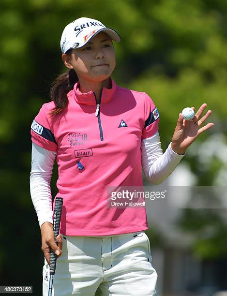 Sakura Yokomine of Japan waves to the gallery on the tenth hole after making par during the third round of the US Women's Open at Lancaster Country...