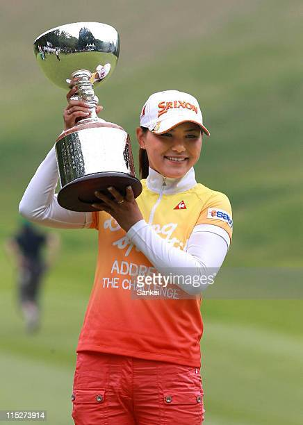 Sakura Yokomine poses for photographs with the trophy after winning the Resort Trust Ladies at Grandee Karuizawa Golf Club on June 5 2011 in Miyota...