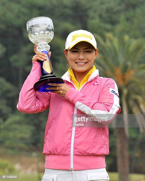 Sakura Yokomine poses for photographs with the trophy after winning the LPGA Tour Championship Ricoh Cup at Miyazaki Country Club on November 28 2009...