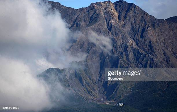 Sakurajima volcano stands in Kagoshima Japan on Sunday Oct 26 2014 Japans economy tumbled into its steepest contraction in more than five years after...