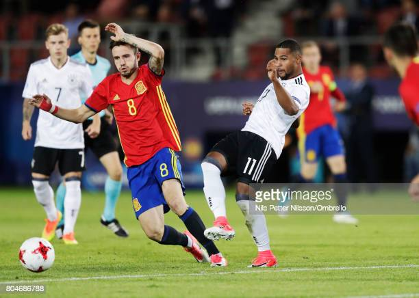 Saúl Ñíguez of Spain and Serge Gnabry of Germany competes for the ball during the UEFA U21 Final match between Germany and Spain at Krakow Stadium on...