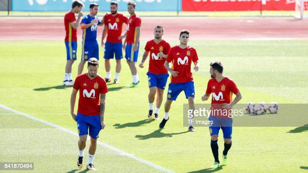 Saúl Ñíguez of Spain David Villa of Spain Marc Bartra of Spain and Suso of Spain looks on during a training session on August 31 2017 in Madrid Spain